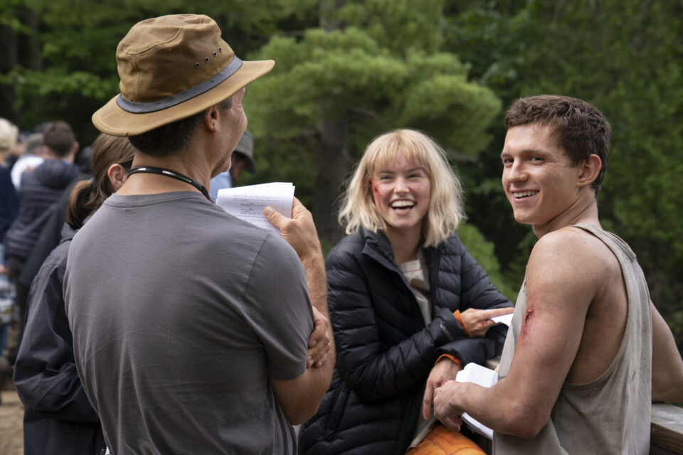 Director Doug Liman, Daisy Ridley, and Tom Holland on the set of CHAOS WALKING. Photo Credit: Murray Close